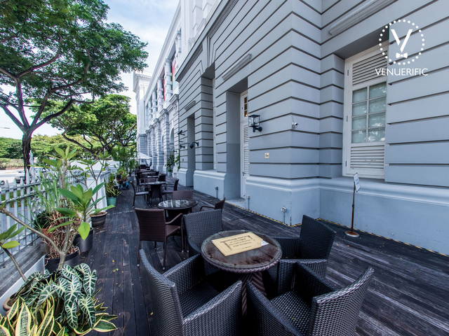 singapore outdoor gathering space with wooden floors and plants surrounds