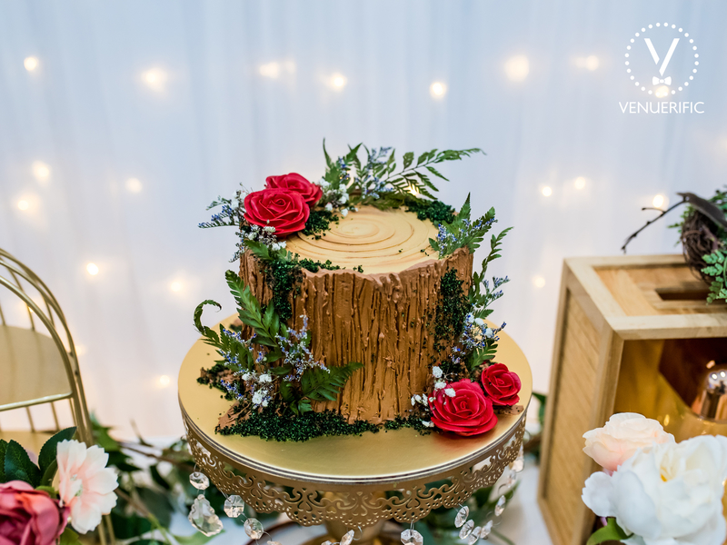 singapore brown wedding cake with red flowers decorations