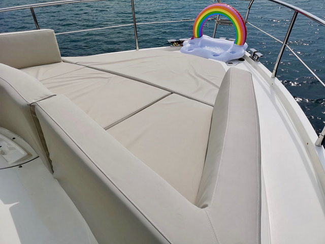 large beige couch and rainbow display in singapore party boat