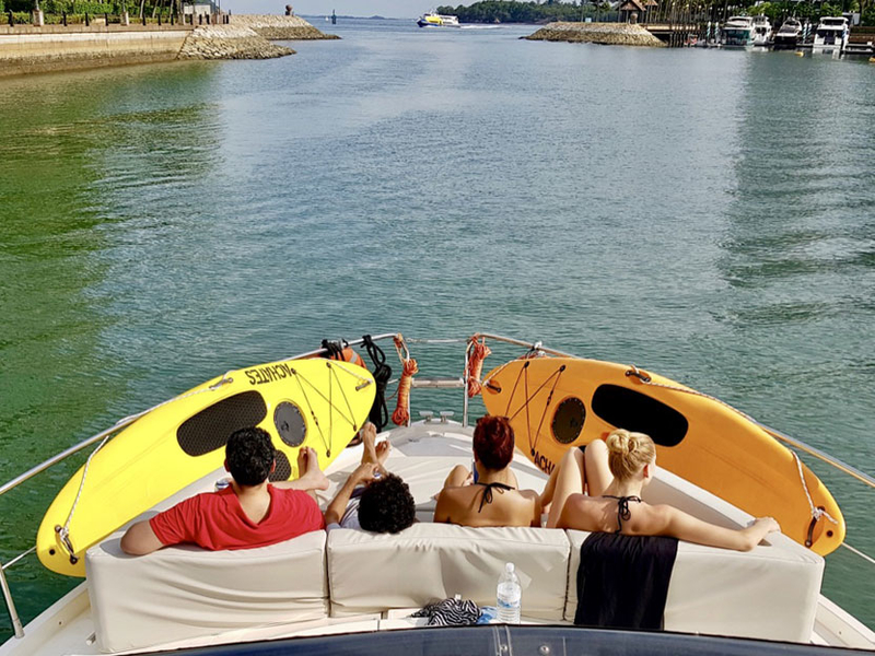 group of people seating in singapore party boat