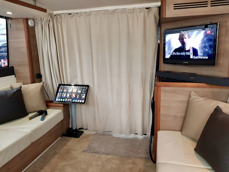 family trip boat in singapore with karaoke facility and long couches