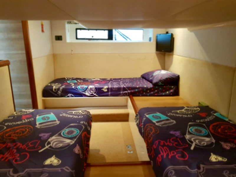 lower deck of singapore boat with threen mini bed