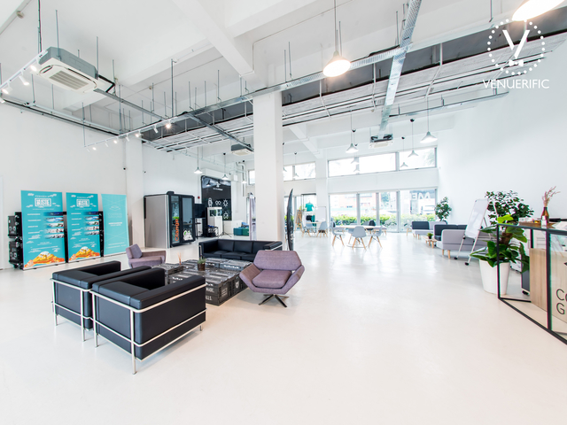 large workshop space in singapore with white interior and big pillar