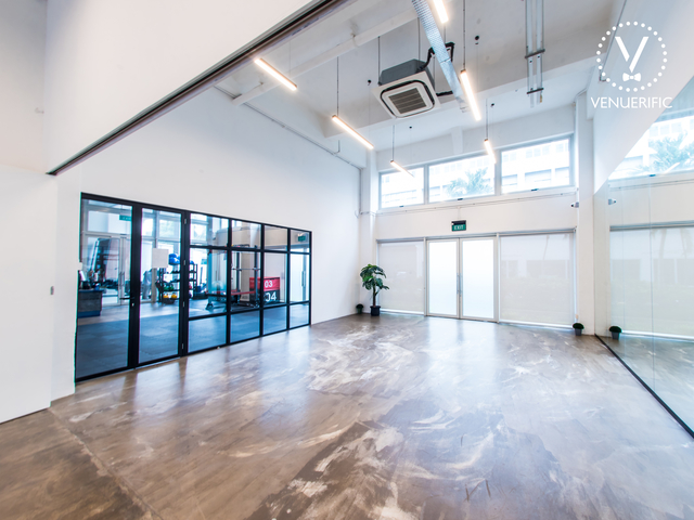 large venue in singapore with white interior and glass door