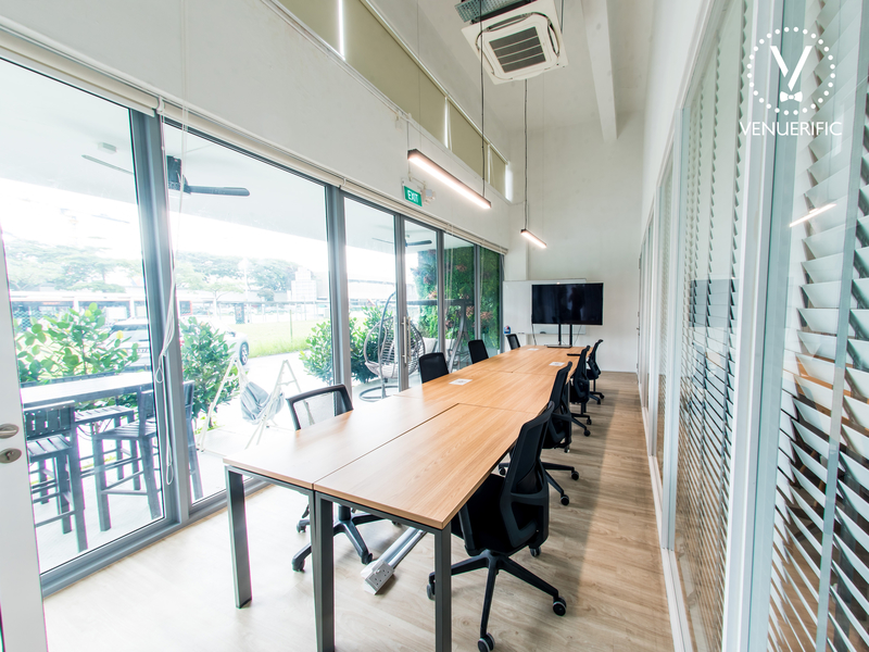 singapore meeting room with large glass wall and tv screen