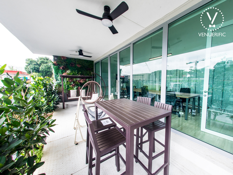 semi outdoor venue in singapore with fan and swing chair