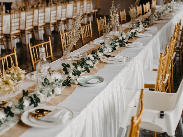 long dining table with flowers decoration in singapore wedding place