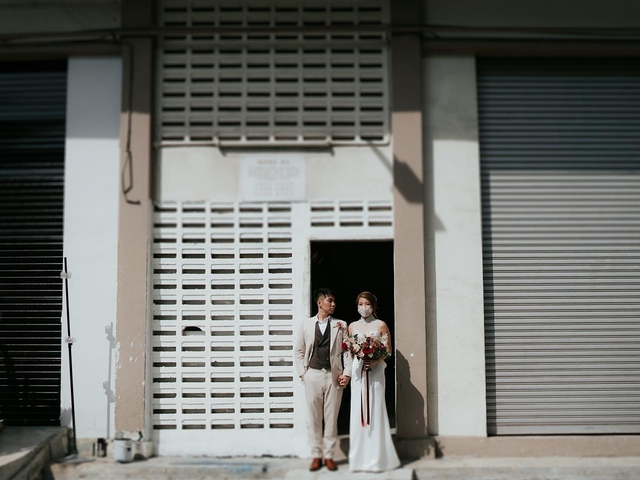 bride and groom standing in black and white singapore house