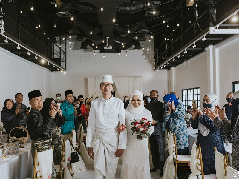 large wedding warehouse with white interior and track lights in singapore