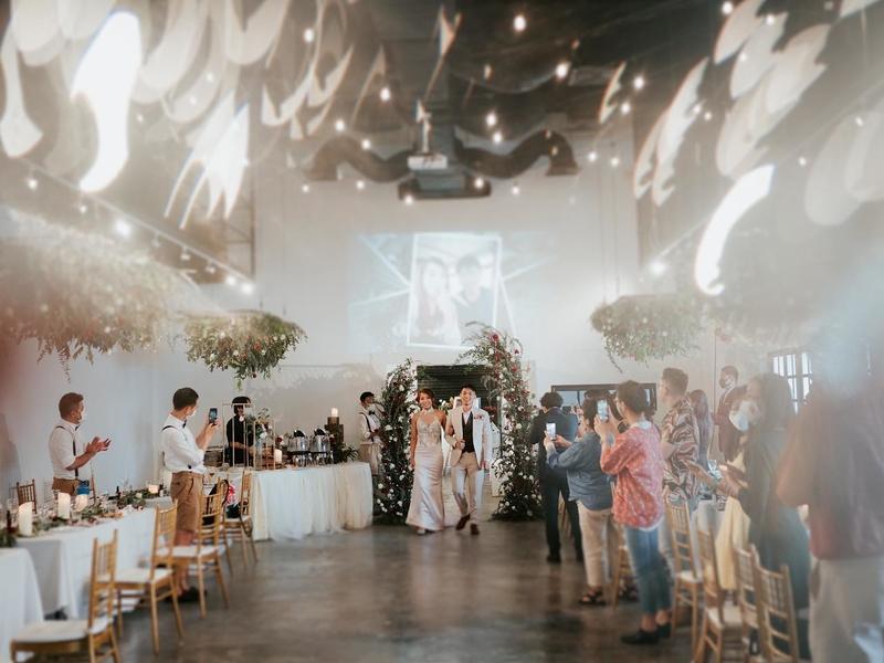 bride and groom walking in singapore large wedding venue