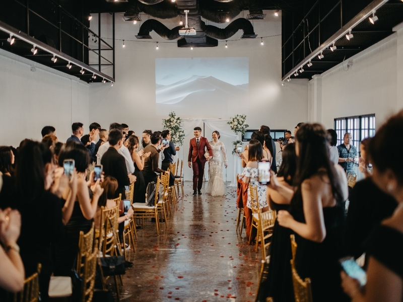 high ceiling wedding venue in singapore with white interior and track lights
