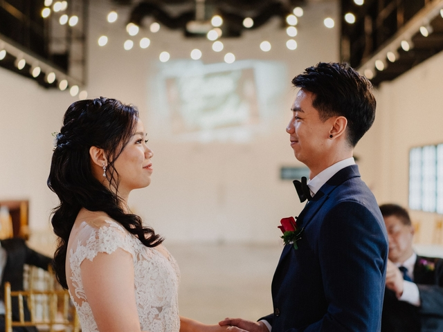 bride and groom look at each other in singapore black and white wedding venue