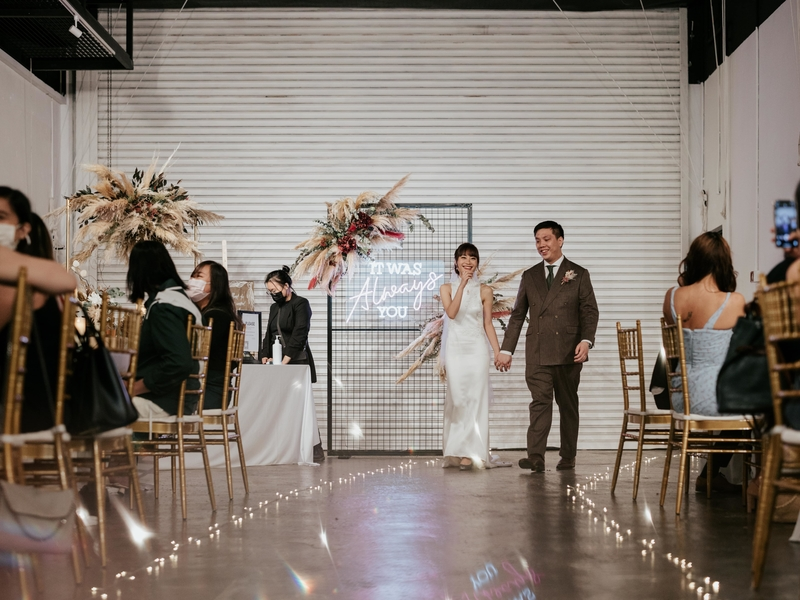 white interior wedding hall in singapore with flowers decorations and fairy lights on the floors