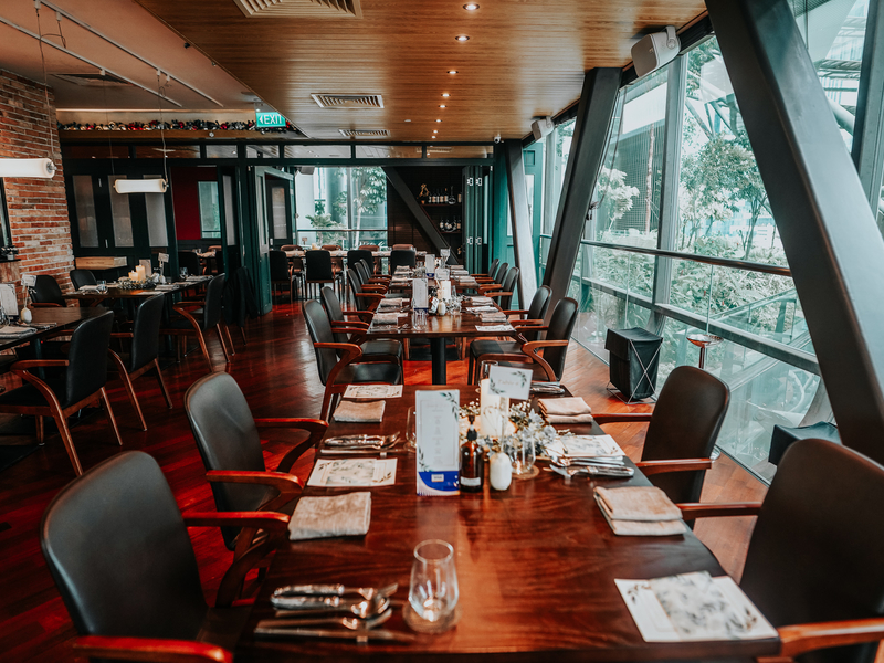 singapore restaurant with long dining table and large glass wall