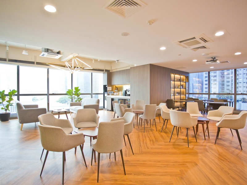 large windows and group seating in singapore function room