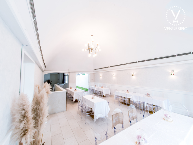 singapore event space for birthday with white interior and arch ceiling