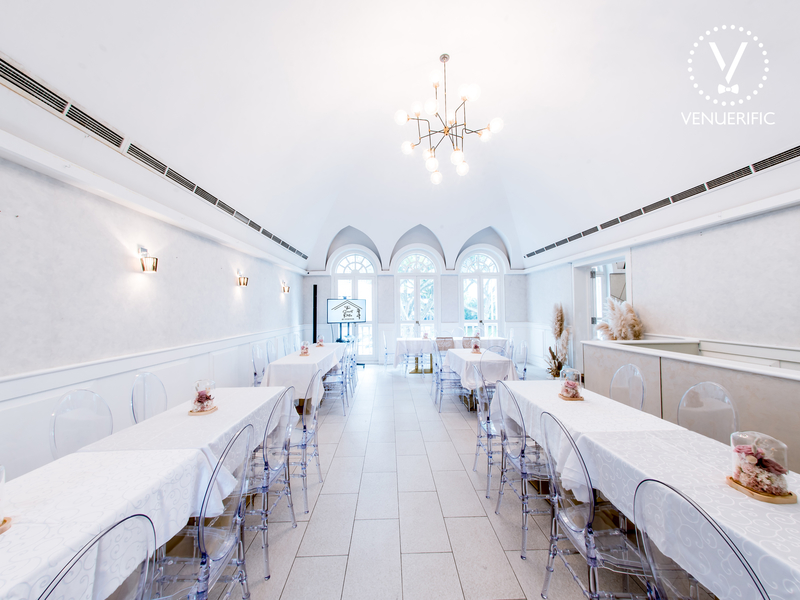 arch ceiling room in singapore with white interior and long dining table