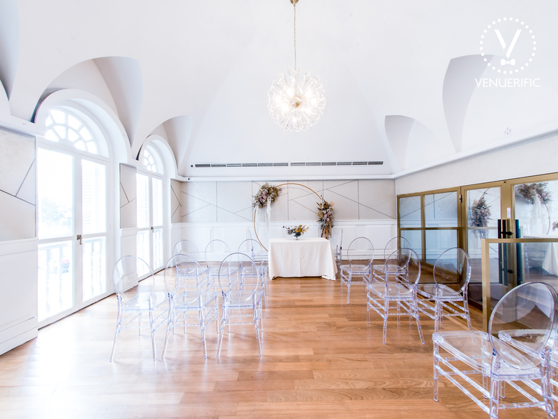 small room with wooden floors and arch ceiling in singapore wedding venue