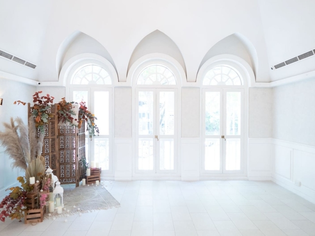 arch windows and white interior in singapore small event space