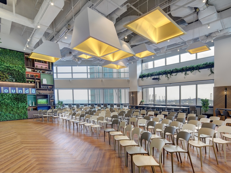 function room in singapore with large windows and wooden flooring