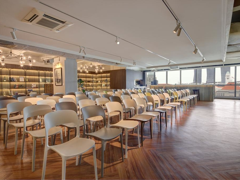 large windows and track lights in singapore seminar space