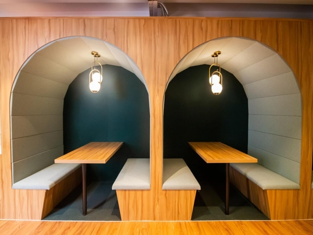small meeting space in singapore with arch interior and pendant lamps