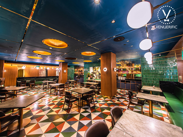 21st birthday party space in singapore with colourful floors and several square tables