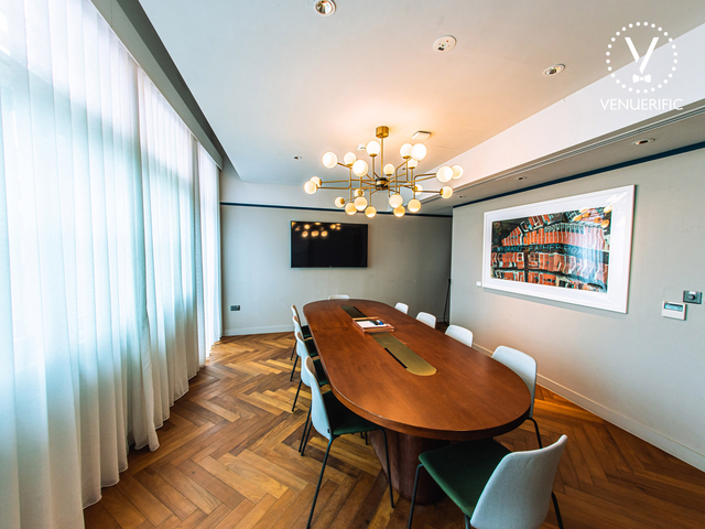 private room restaurant in singapore with oval table and white curtain