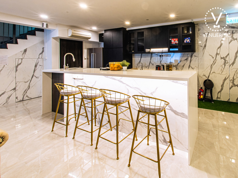 wedding venue in singapore equipped with white interior pantry and bar stools