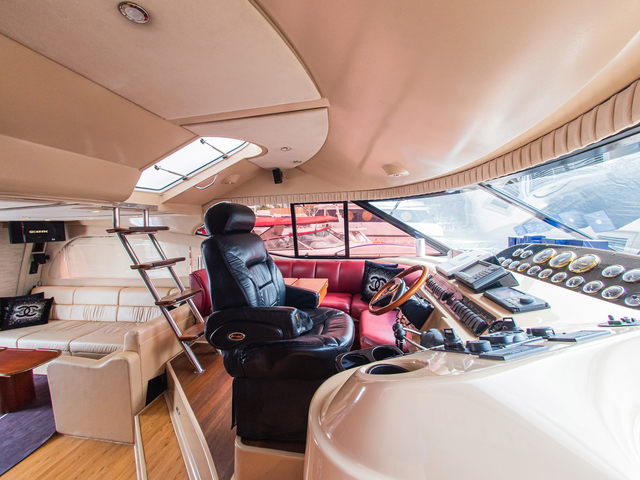 party yacht in singapore with black captain chair and small stairs