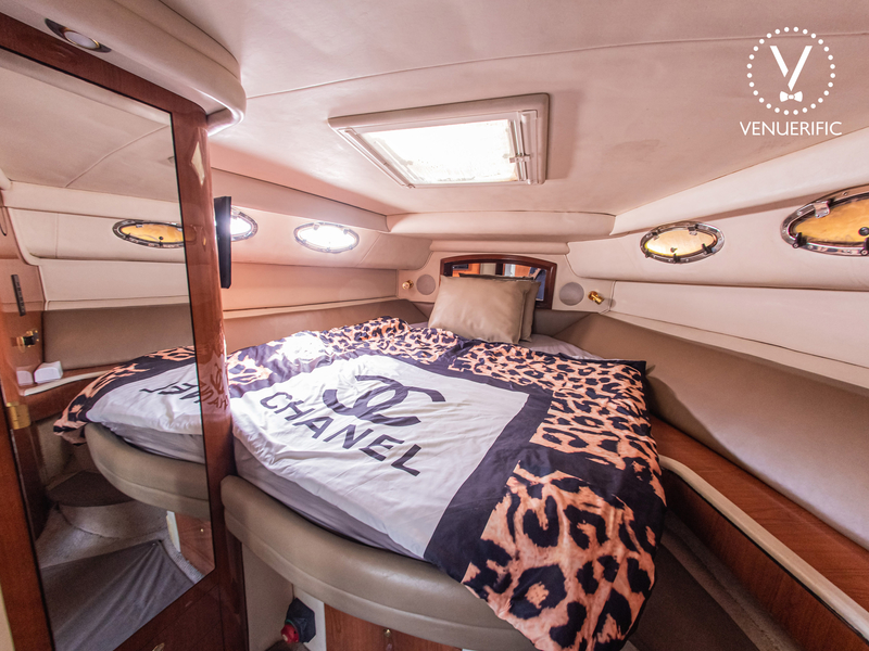 singapore overnight yacht with small bedroom and beige interior