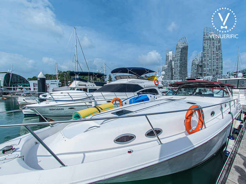 white party yacht in singapore harbour with large upper deck