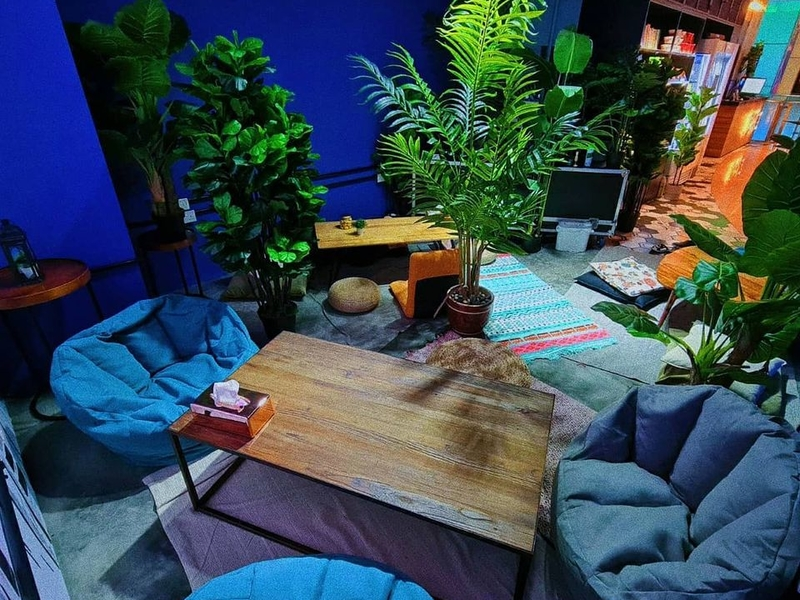 several floor cushions and plants inside singapore gathering space