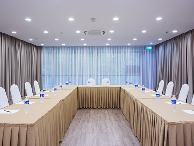 singapore function room with u-shaped seating and drapes