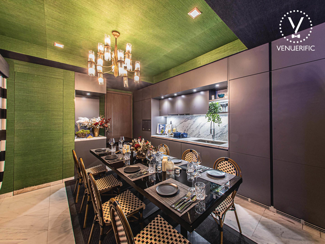 private event venue in singapore with green walls and mini kitchen