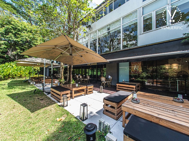 restaurant in singapore with large terrace area and equipped with wooden box stool