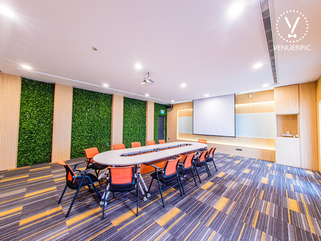 large meeting space in singapore with ovale table and projector screen