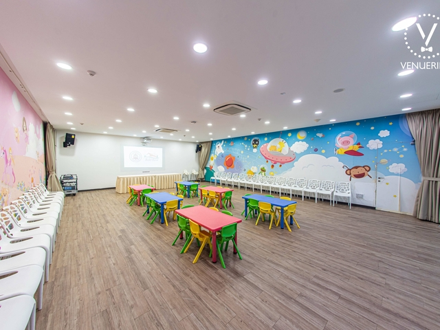 singapore large function room with colourful kids chairs and cartoon wallpaper