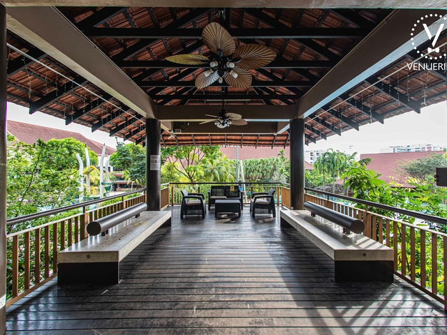 small event space in singapore with wooden floors and garden view