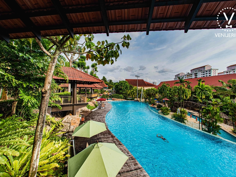 large outdoor pool in singapore with garden party area