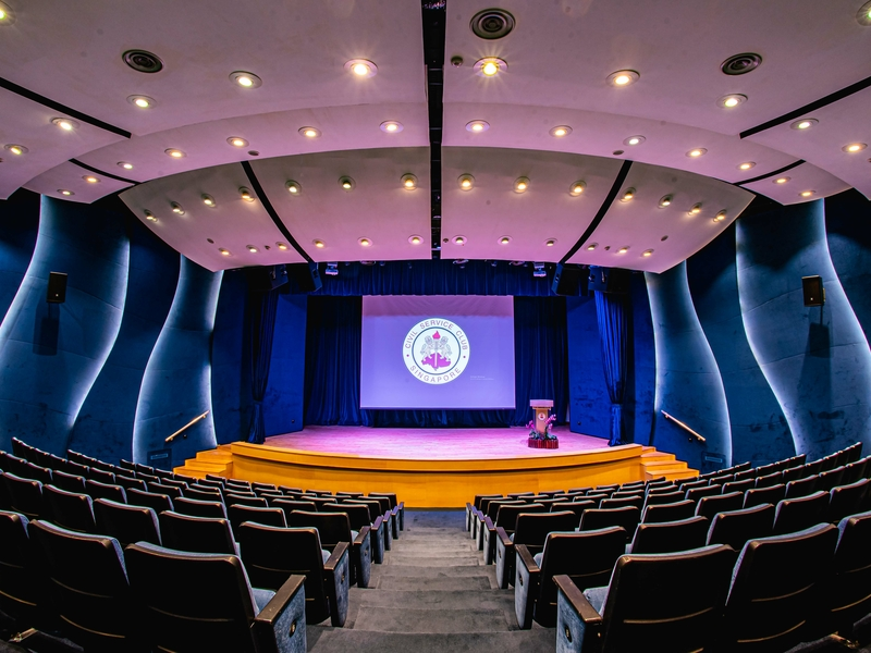 large auditorium in singapore with blue wall and stage