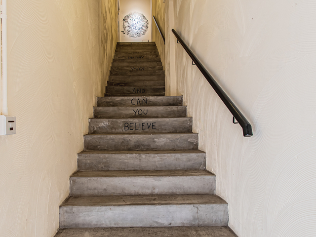 artistic stairs with quotes in every step