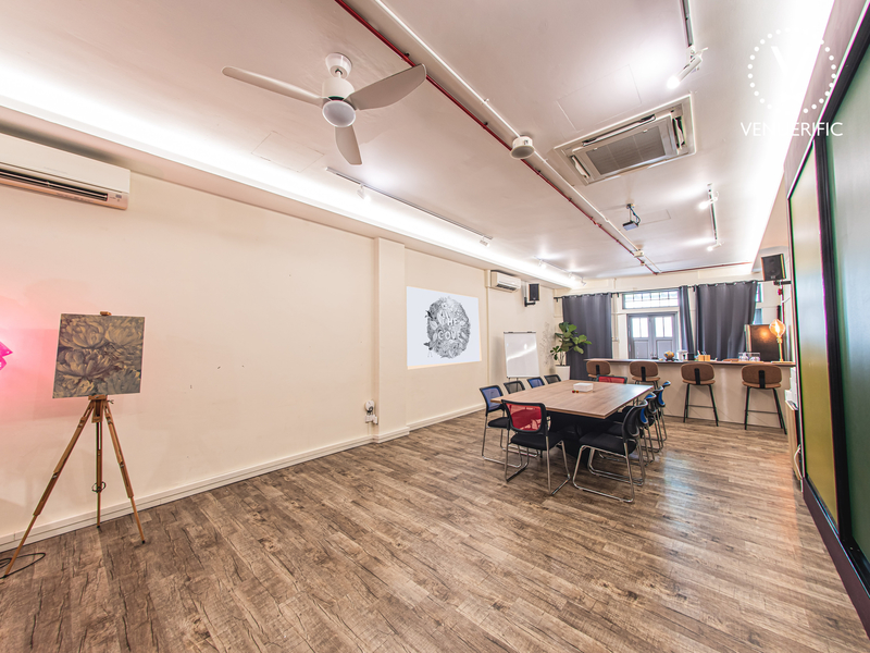 event space area with wooden floor and table setup