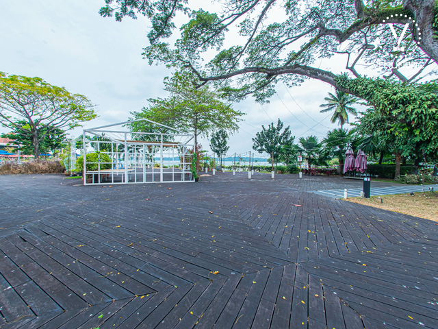 outdoor christmas party venue in singapore with wooden floors and sea view