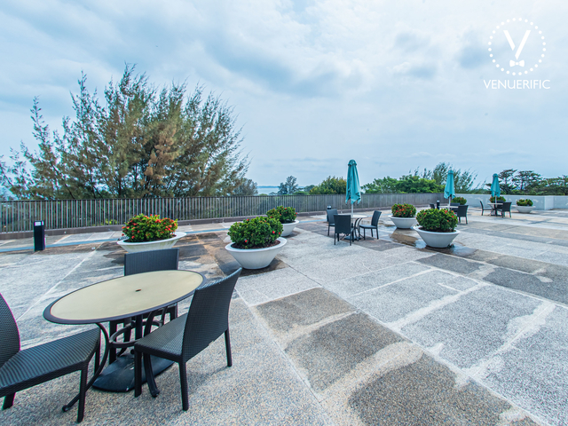 singapore large rooftop party space with sea view and several plants