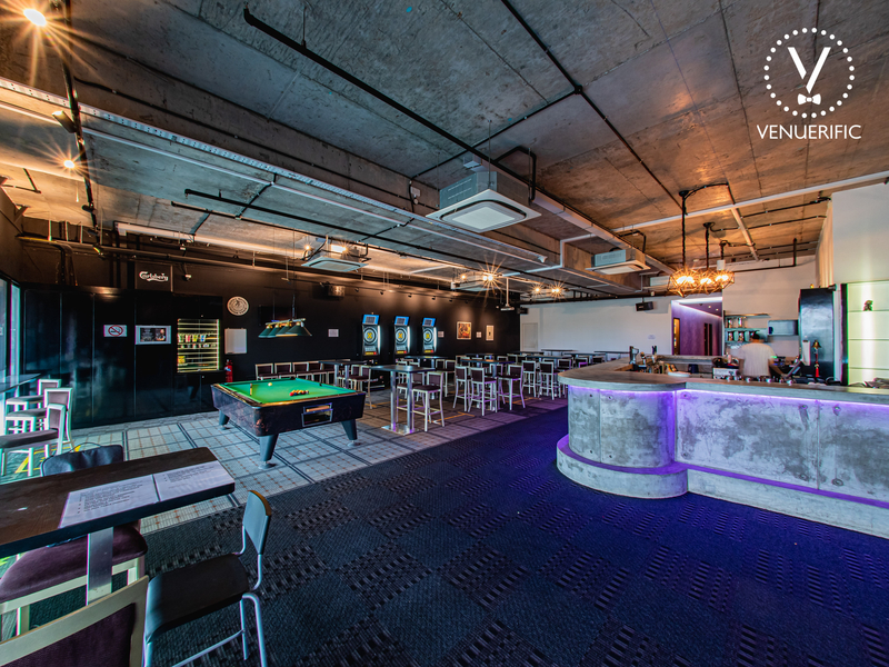 industrial room in singapore with grey interior and pool table