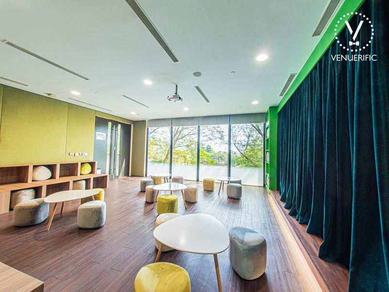 large function room in singapore with garden view and low chairs
