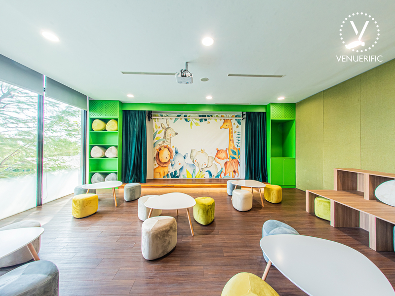mini stage and low chairs in singapore kids birthday party venue