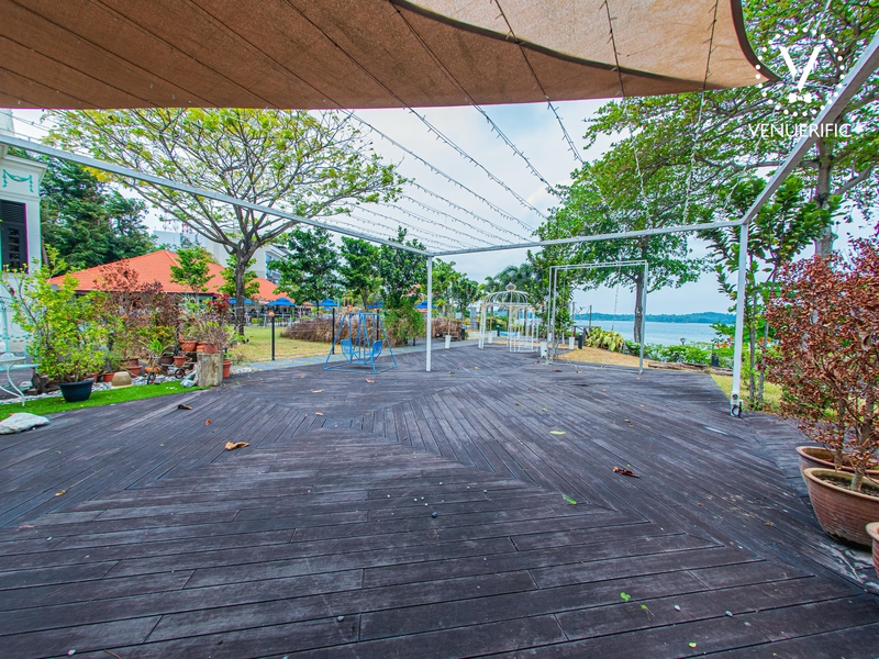 large outdoor party venue with wooden floors and sea view