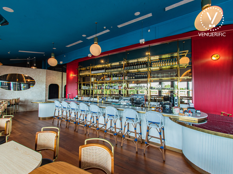wooden floors bar in singapore with blue-red wall and drinks display